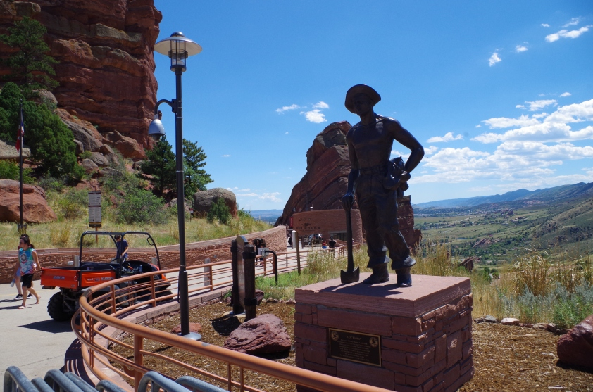 A monument to the Civilian Conservation Corps members who built the Amphitheater, along the path in. The Two monolithic rock formations are on either side of the seating area.